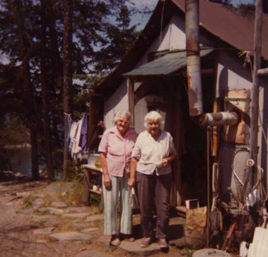 Color image of Dorothy Molter and Ruth Molter at Point Cabin, Isle of Pines, Knife Lake, Boundary Waters Canoe Area ca. 1980s.