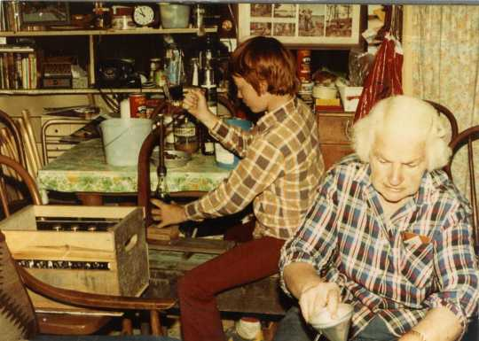 Color image of Dorothy Molter and John Kimbler bottling root beer, Isle of Pines, Knife Lake, Boundary Waters Canoe Area, ca. 1970s.