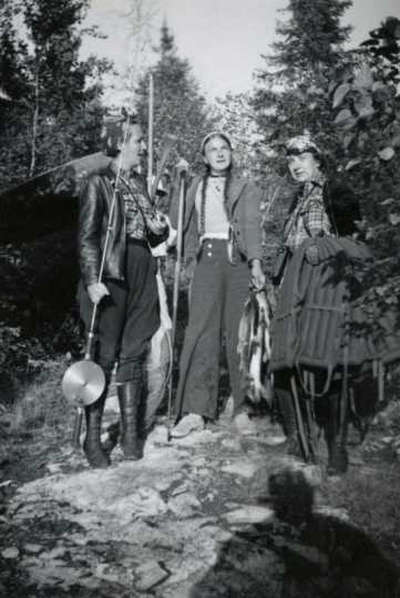 Black and white photograph of Dorothy Molter, Jule, and Verena at Bearskin Portage in the Boundary Waters Canoe Area Wilderness, ca. 1960s.