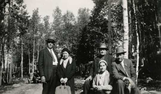 Black and white photograph of Molter family and friend, ca. 1930.