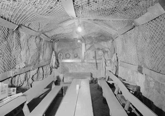 Black and white photograph of the underground (twenty-seven levels below the surface) miners' lunchroom in the Soudan Iron Mine, Lake Vermilion–Soudan Underground Mine State Park.